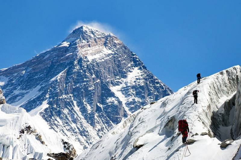 trekkers in Nepal mountains