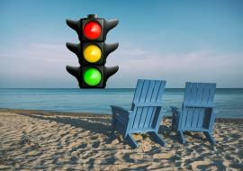 beach, two beach chairs and a traffic light
