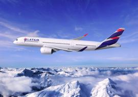 LATAM aircraft in the air over mountains