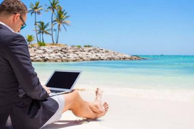 businessman with laptop at the beach