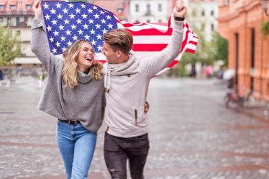 American couple with American flag